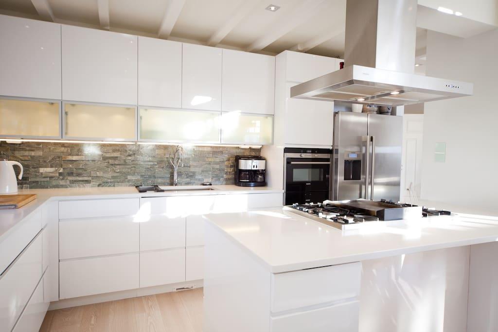 Modern kitchen - gas top , microwave, wine cooler, dishwasher, coffee machine.