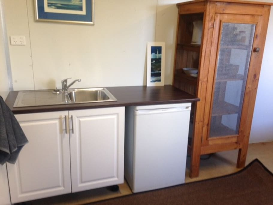 Kitchenette with microwave, kettle and toaster