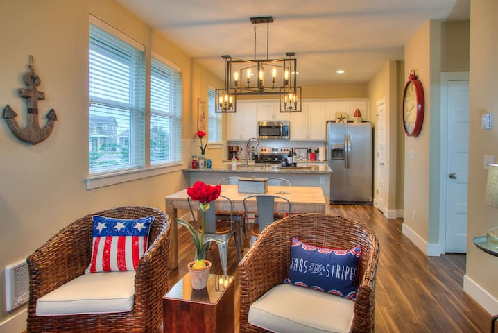 open concept living dining and kitchen areas