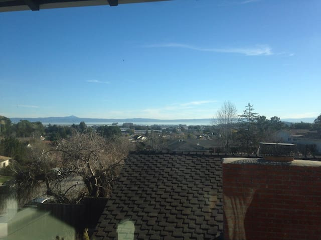 View of the San Francisco Bay and the hills of the east bay. Guests can also enjoy watching planes land at SFO.