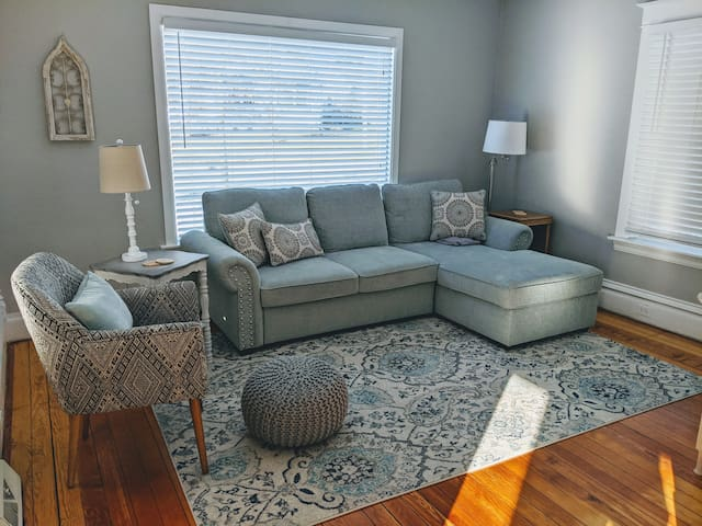 The bright and cheery living room is a great place to curl up and enjoy a night in.