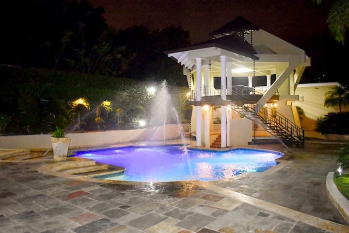 Pool view at night with fountain