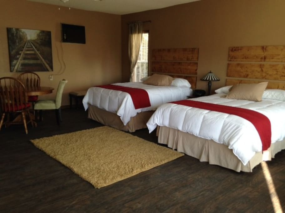 Two queen-sized beds easily accommodates four people.