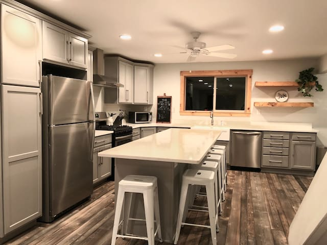 The beautiful kitchen features stainless steel appliances, plenty of counter space, and extra seating.
