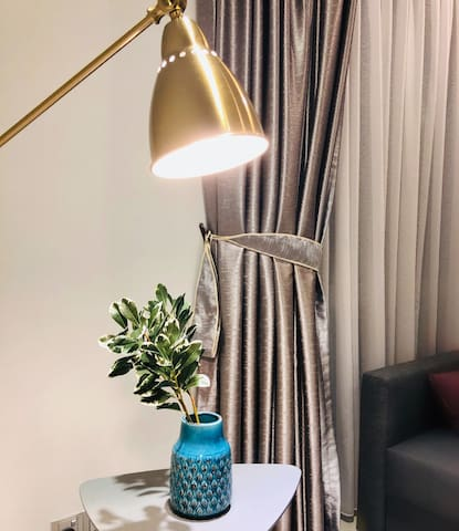 Quality brass standing lamp , warm white , cozy living with amazing deco