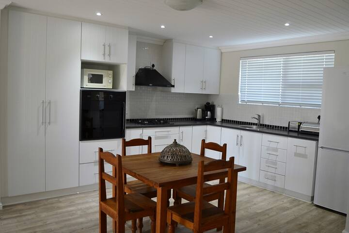 Brand new open plan kitchen with gas hob and electric eye level oven.