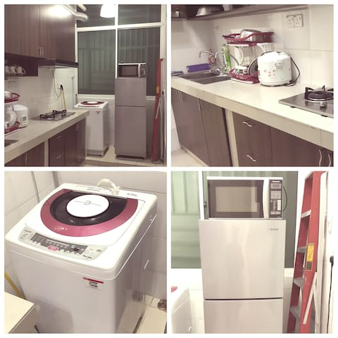 Kitchen and laundry area. kitchen complete with stove and microwave and also kitchen utensils