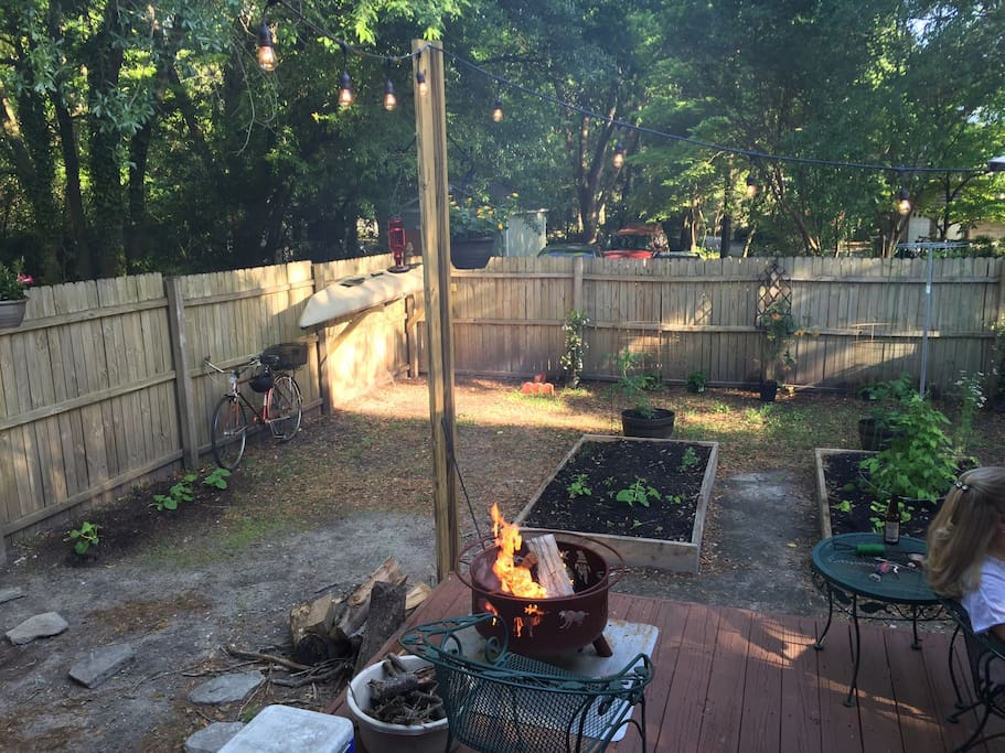 The back deck and yard. Has two fire pits, patio set and grill.