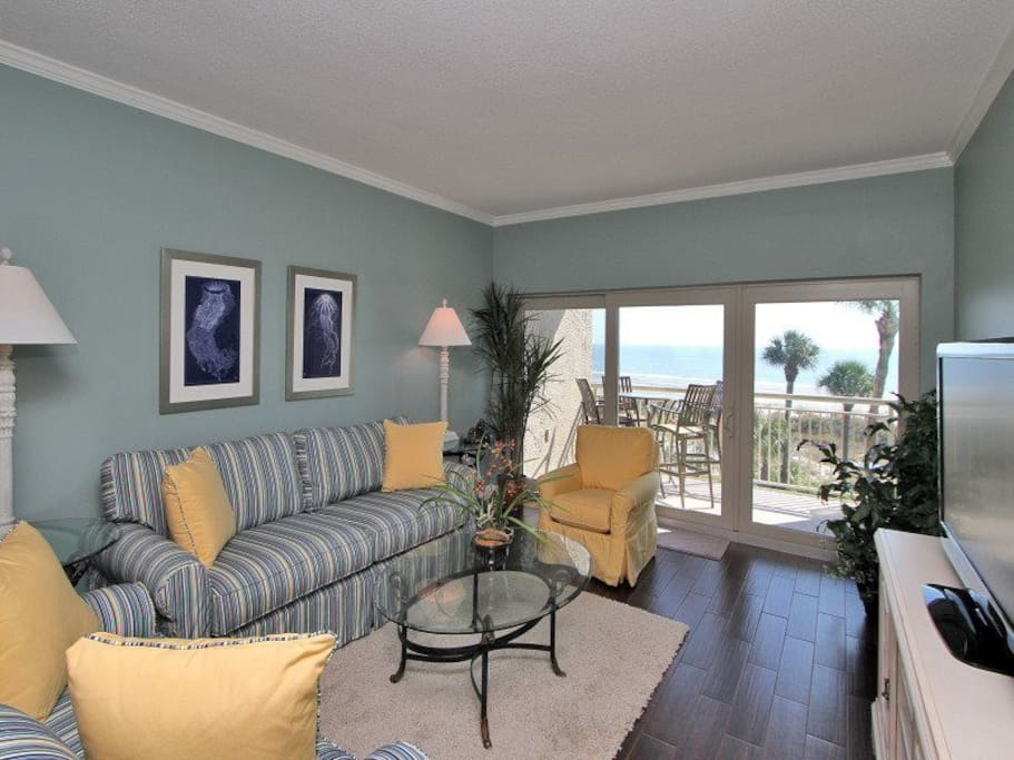 Living Room with Balcony Access and Oceanfront Views