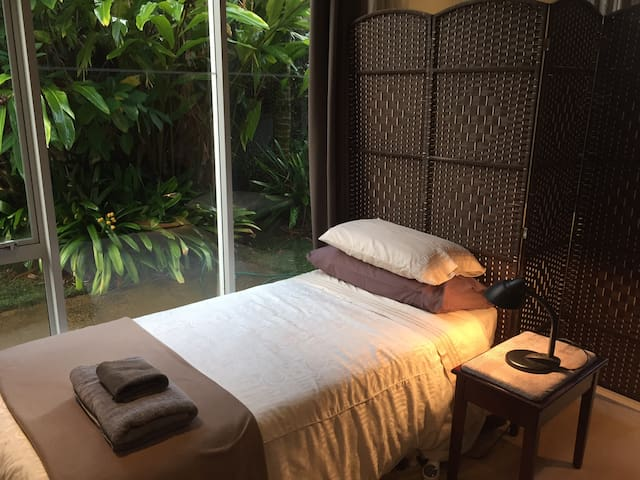 Single bed in private area off lounge