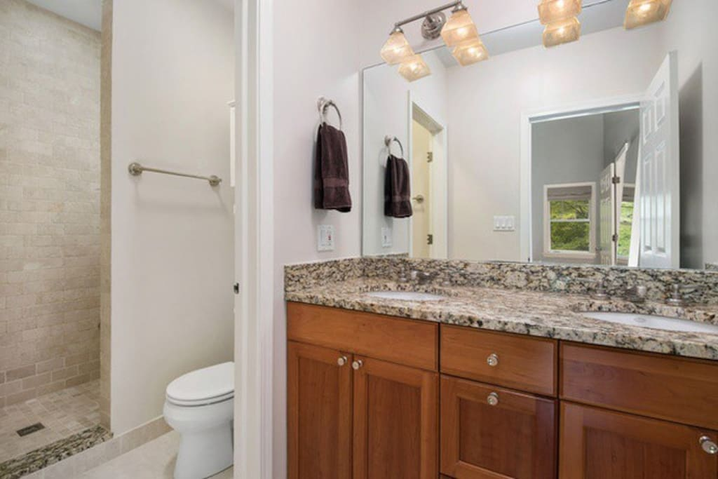 Master bath (1 of 3) includes walk in shower with bench and double sinks