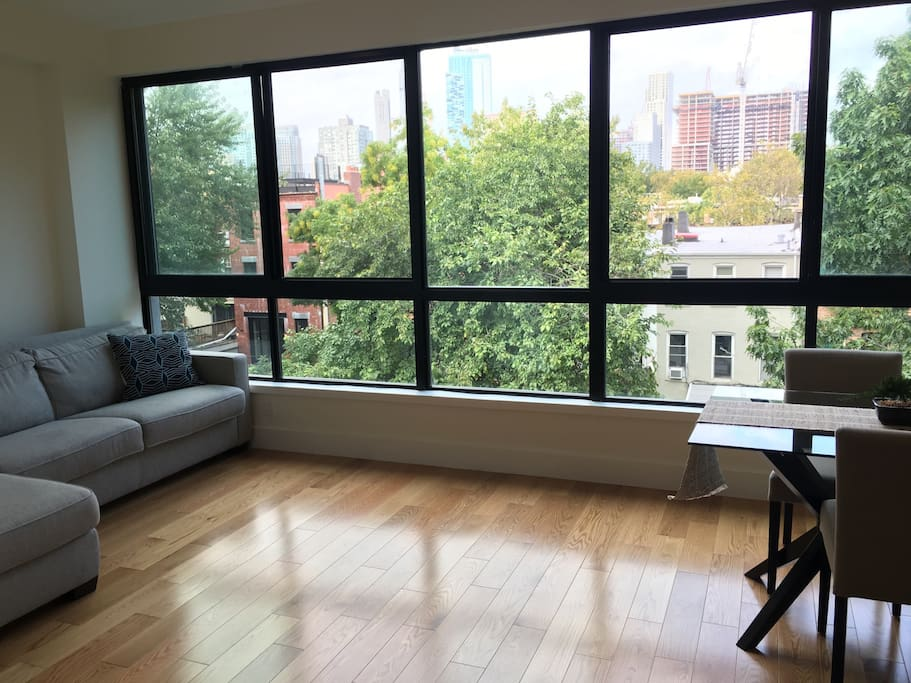 Huge windows give a 180 degree views of the Brooklyn skyline and lots of trees