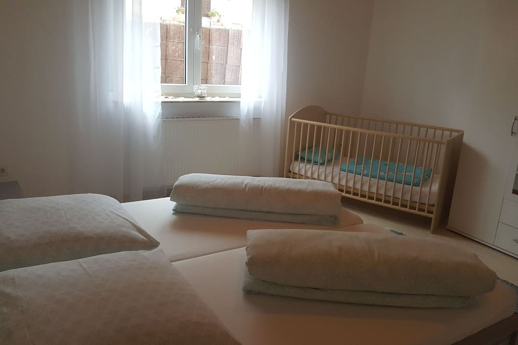 Master bedroom with a bed for children included