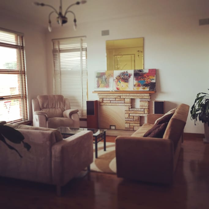 Living/lounge room, artsy upstairs common area shared