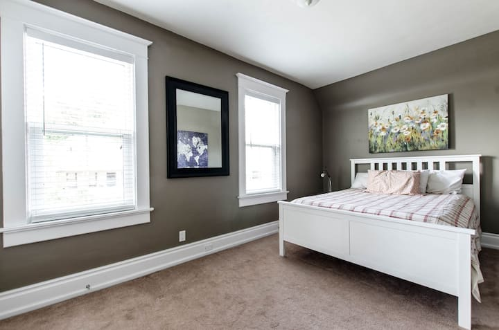 Master bedroom in a charming century home.