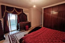 King Bed large Bedroom with a private toilet and balcony overlooking the woods, sea, and the village (angle3)