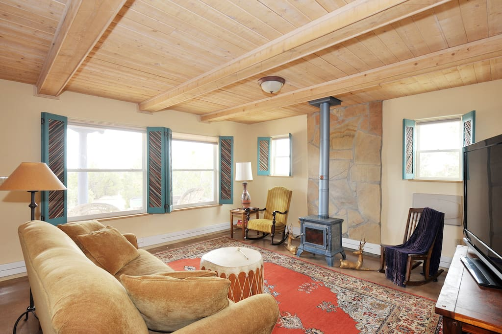 Enjoy the living room, with its cozy couch, Persian rug, and Native American drum.