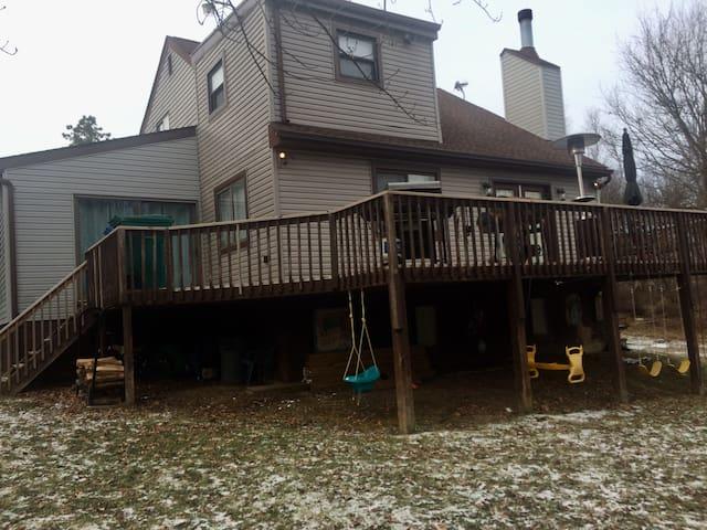 Back deck has a few swings also a baby swing for the kiddos. Flat Land  Yard.... A bonus.