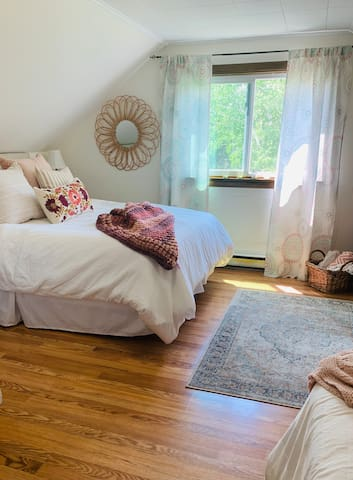 The front bedroom has a spectacular view and the most amazing sunlight with plenty of room for both a queen and a full size beds.