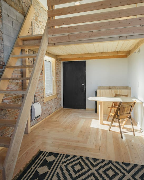 the stairs up to your bed nest and the breakfast nook/ mini conference table
