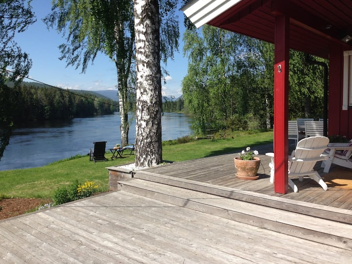 Idyllic country house,jetty and beach at the river