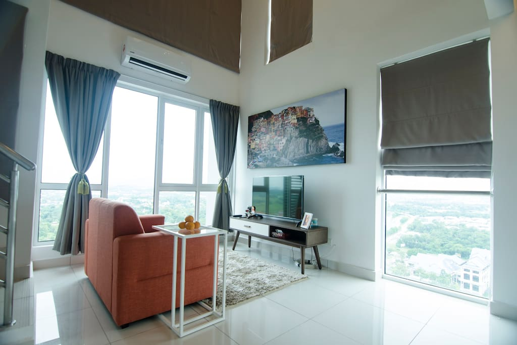 Living room with multiple large windows