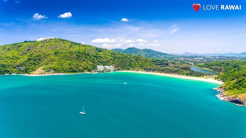 Nai Harn beach which is a 5 minute drive away. A favorite among our guests. You can rent a beach chair there or lay a beach mat down ( which we provide for you. ) and enjoy the beautiful surroundings.