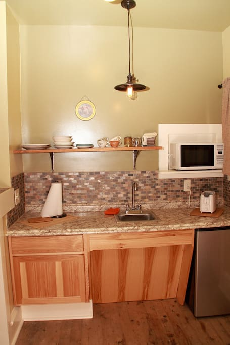 Handicap accessible kitchen! Refrigerator, micro wave, coffee maker, toaster, dishes and flatware!