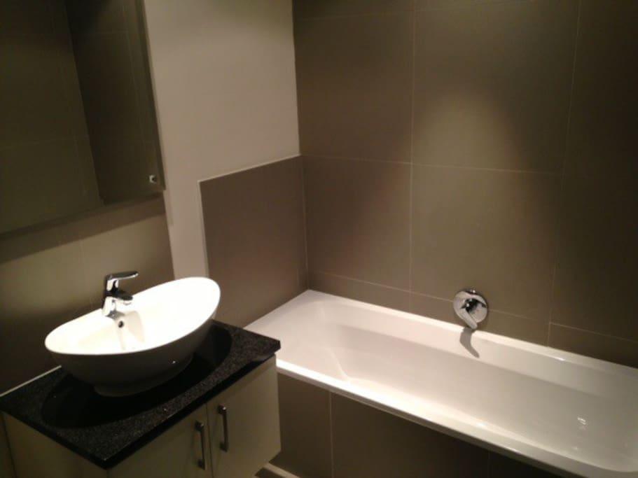 Main-en-suite bathroom has a bath and a shower