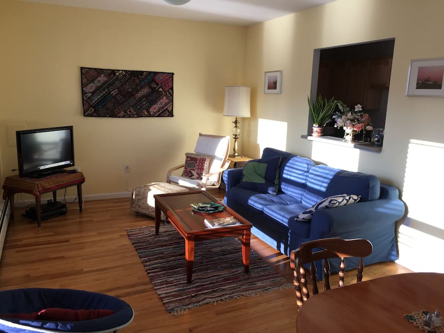 Sunny living/dining room with window to kitchen. (Includes AC, wifi, cable TV and more...)