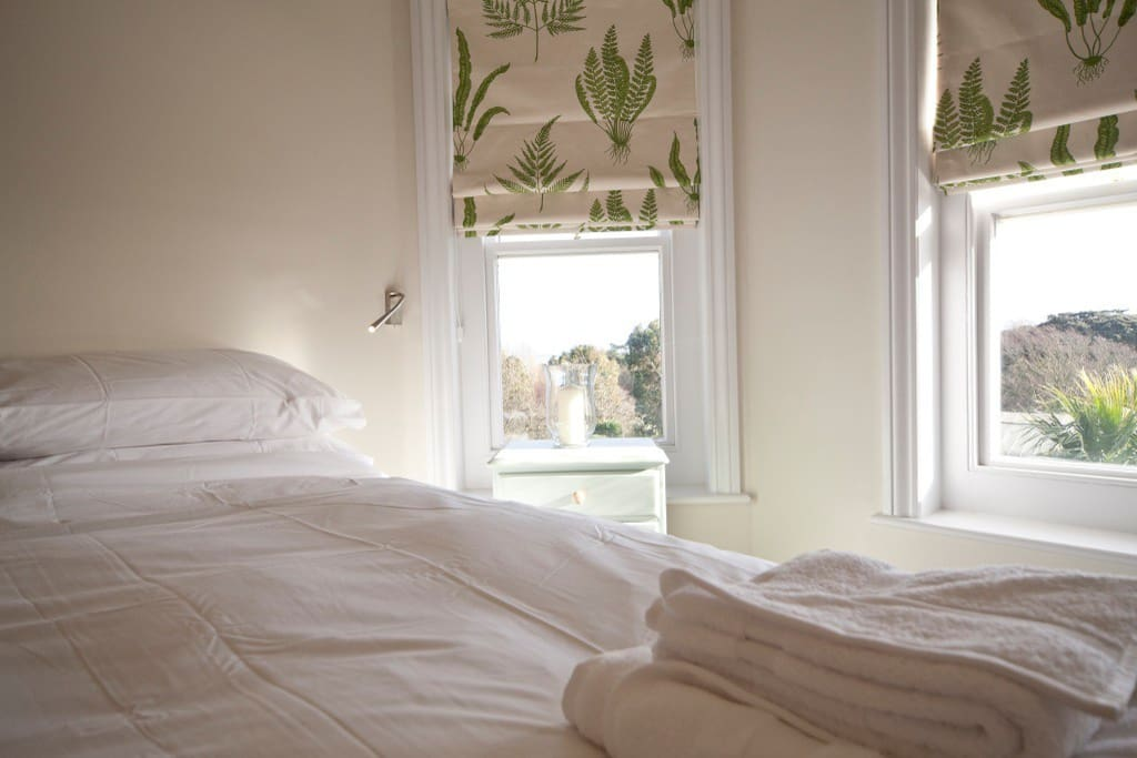 The master bedroom boasts views over the Garden and English Channel