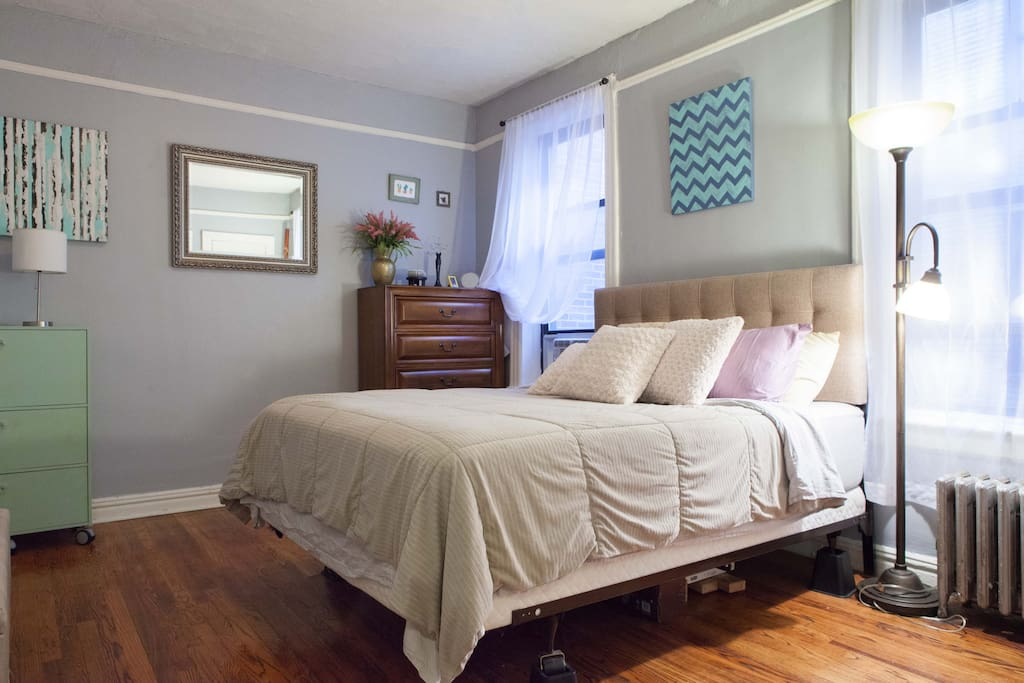 Large, cozy master bedroom with luxurious, incredibly comfortable Queen-sized bed and large dresser providing plenty of storage (especially convenient for our longer-staying guests).