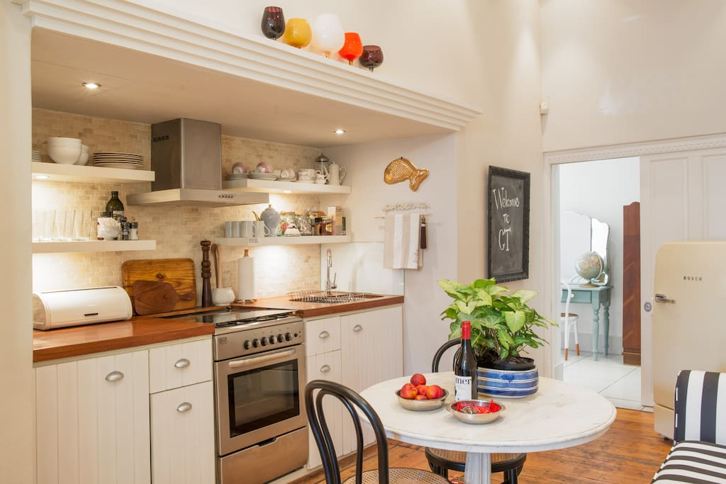 The eat-in kitchen is cozy and comfortably seats four people.
