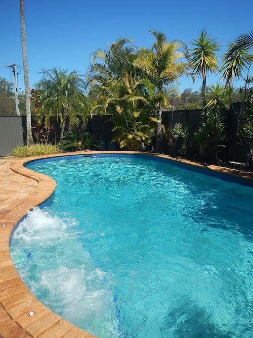 outdoor spa in pool steps