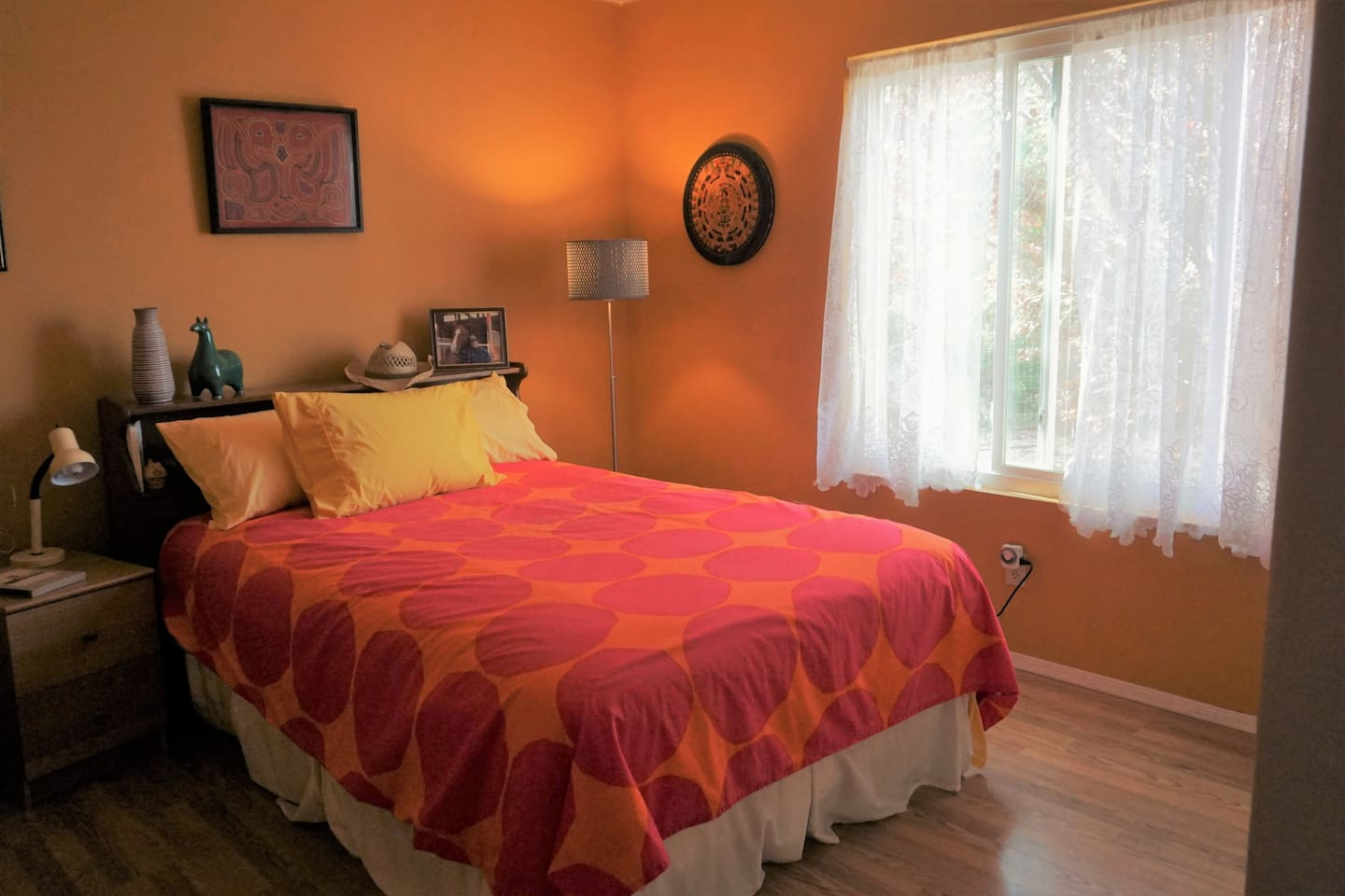 The bright, south-facing Yellow Room has a firm, full-sized bed and shelving in the closet