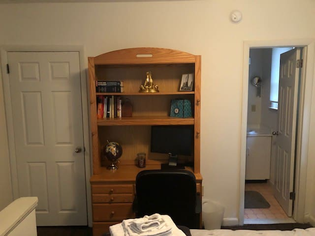 Walk in closet, work space and bathroom.