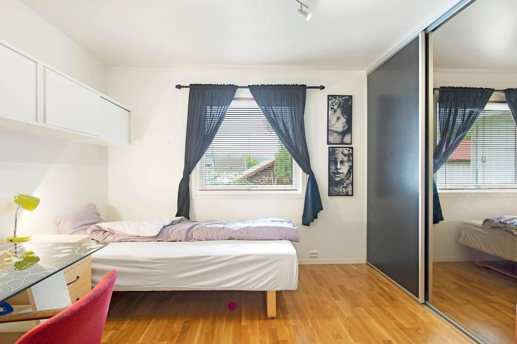 Large bedroom with new (soon) double bed and plenty of closet space