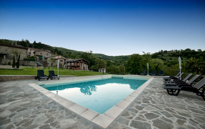 Typical stone house with pool in Tuscany