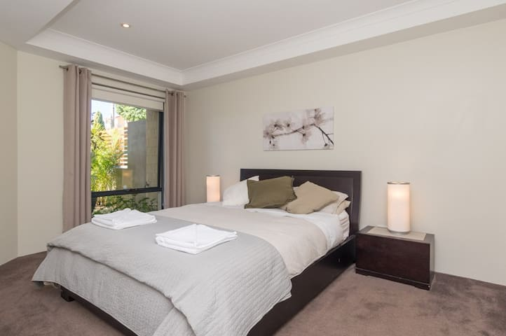 Queen bed and another spacious bedroom