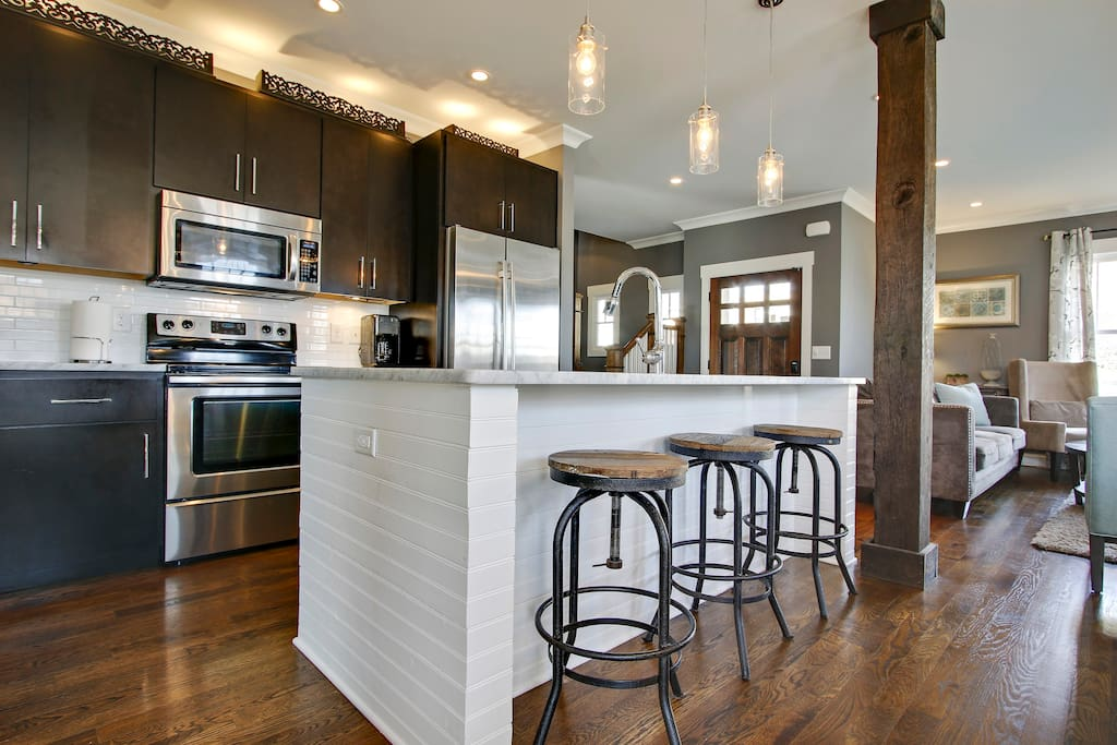 Dark wood cabinets and recessed lighting in the kitchen.