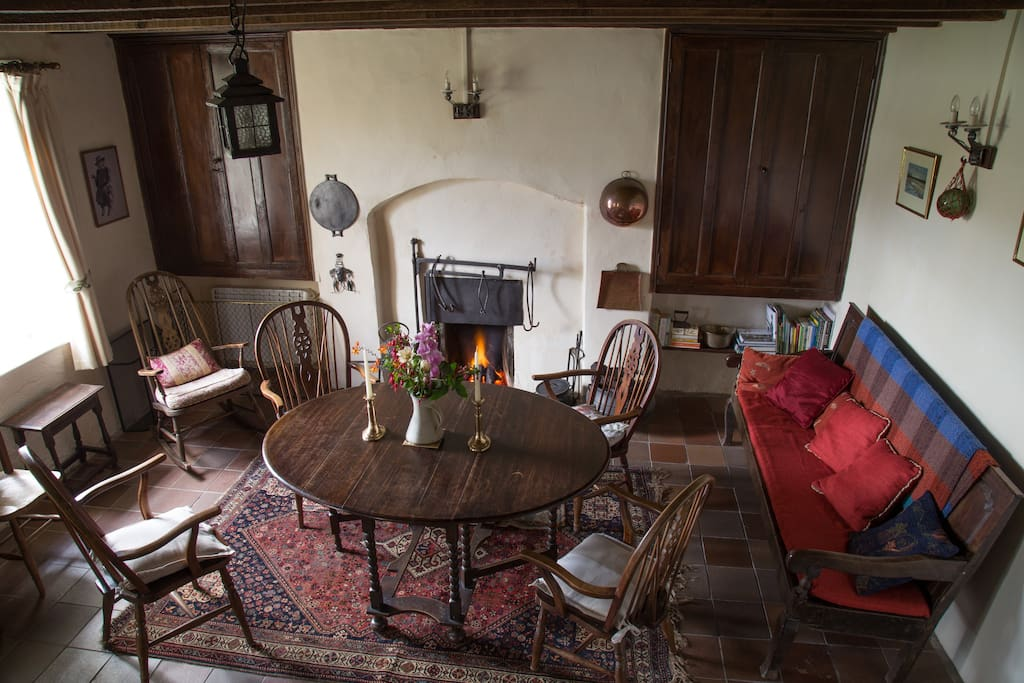 The nineteenth century farmhouse retains its traditional fireside crane for holding cooking pots in days gone by. Ideal spot for dinners, by candle light, in front of the turf fire.