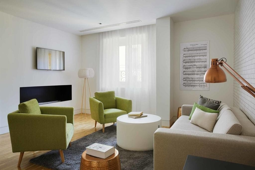 The living area may be furnished in a number of different ways, but it will be equipped with a double sofa bed.