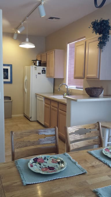 Fully furnished kitchen w/stove microwave, coffee maker, refrigerator, oven, garbage disposal, dishwasher