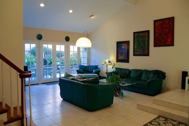Livingroom with attached patio area. French doors let in tons of light and fresh sea air!