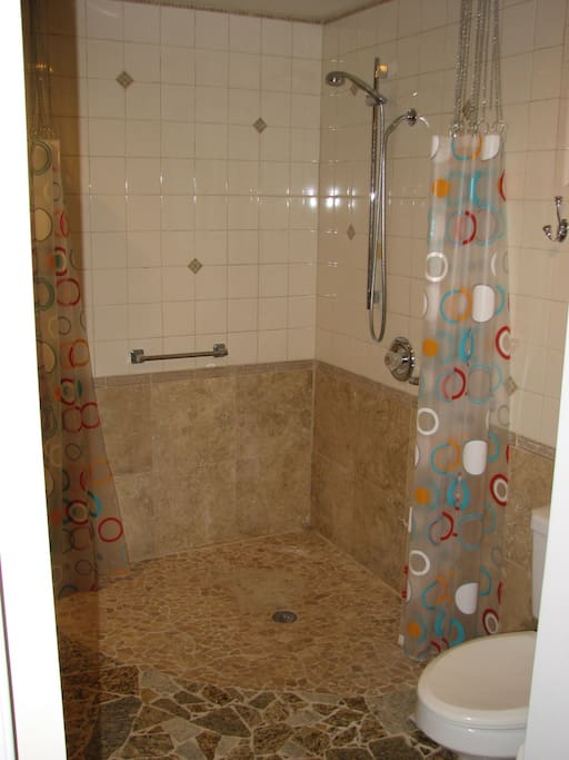 The shower is wheelchair accessible.
