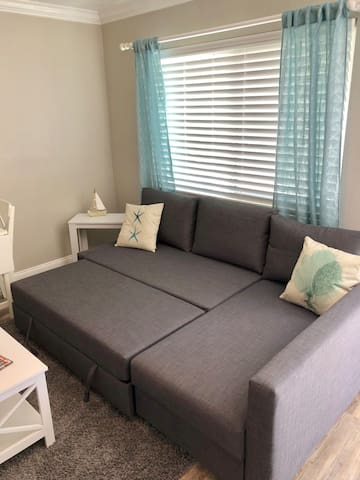 Pullout couch in living room.