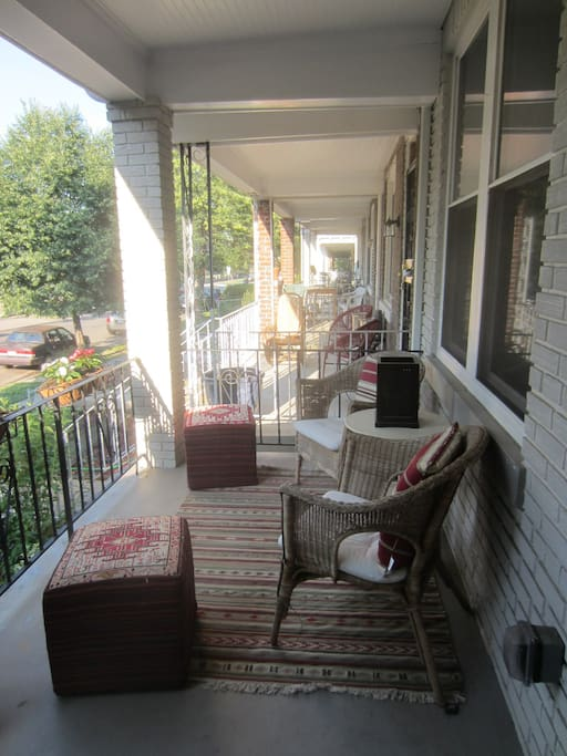 Relax with a glass of wine on the front porch.