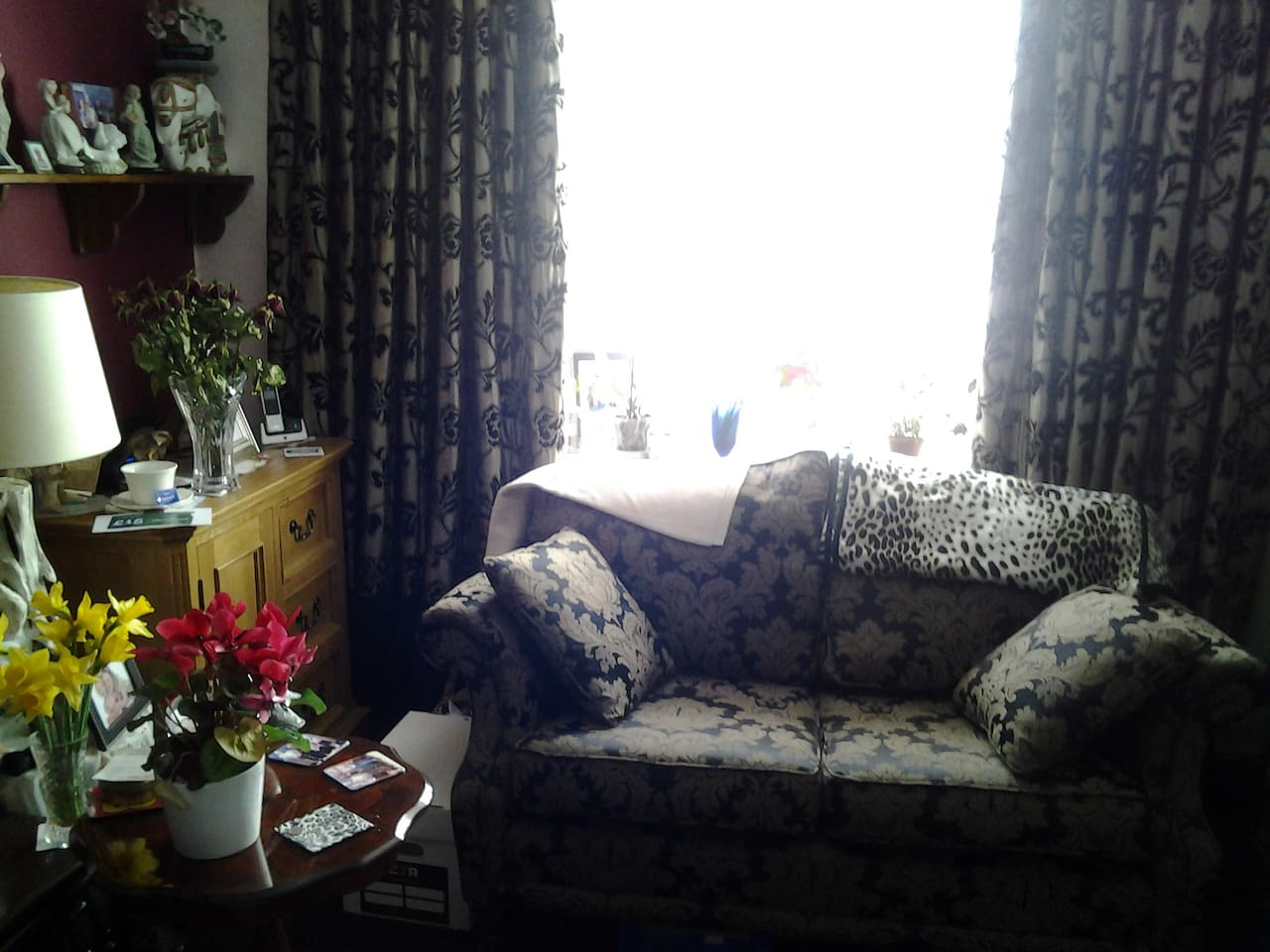 This is  front room with a bay window