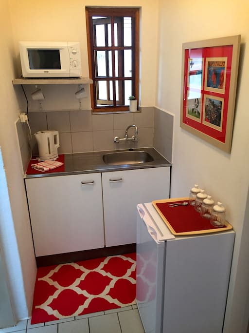 Kitchenette with Fridge, Microwave, Kettle, Toaster and Tea & Coffee.