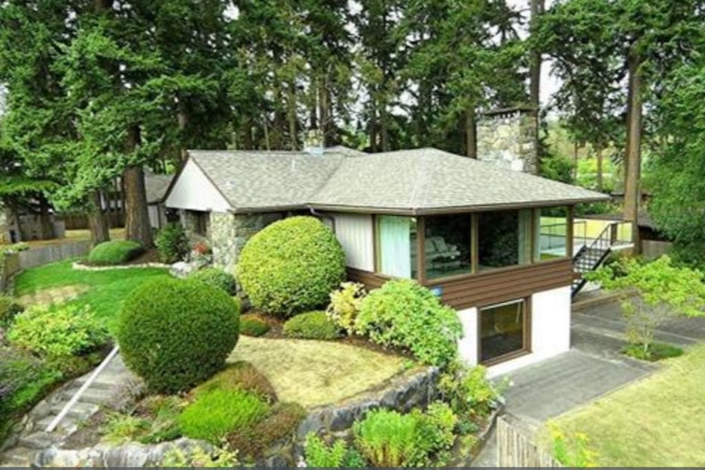 Stunning setting with tall pines behind and the beautiful North Puget Sound in front.